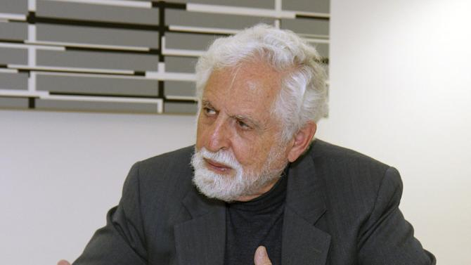 """FILE - In this Oct. 20, 2009 file photo, Carl Djerassi talks to Austrian Chancellor Werner Faymann, not seen, at the federal chancellery in Vienna, Austria. Djerassi, the chemist widely considered the father of the birth control pill, has died of complications of cancer in his San Francisco home, Stanford University spokesman Dan Stober said. He was 91. Djerassi, a professor emeritus of chemistry at Stanford, was most famous for leading a research team in Mexico City that in 1951 developed norethindrone, a synthetic molecule that became a key component of the first birth control pill. """"The pill"""" as it came to be known radically transformed sexual practices and women's lives. (AP Photo/Ronald Zak, File)"""