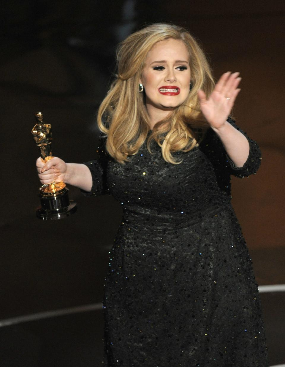 "Singer Adele accepts the award for best original song for ""Skyfall"" from the film ""Skyfall"" during the Oscars at the Dolby Theatre on Sunday Feb. 24, 2013, in Los Angeles.  (Photo by Chris Pizzello/Invision/AP)"