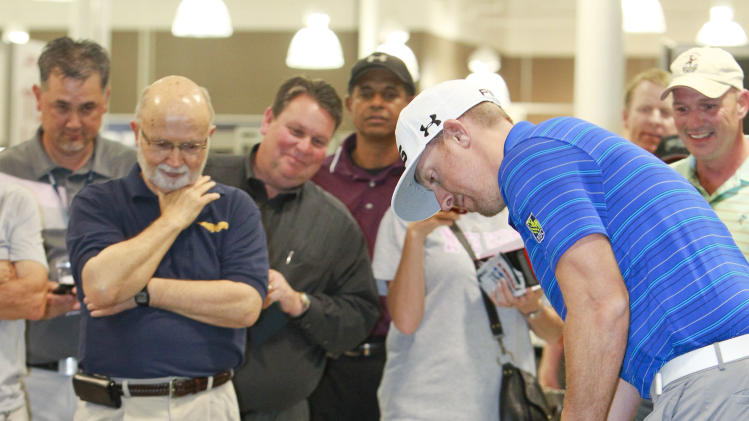 IMAGE DISTRIBUTED FOR GOLF GALAXY - PGA Tour professional Hunter Mahan competes against a local consumer, Kelly Sargent, far right, at Golf Galaxy's grand opening in Grapevine, Texas, on Friday, Nov. 9, 2012. (Brandon Wade/AP Images for Golf Galaxy)