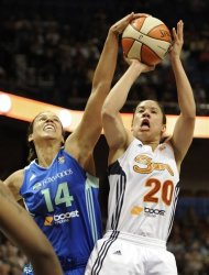 Connecticut Sun's Kara Lawson (20) has her shot blocked by New York Liberty's Nicole Powell during the second half of a WNBA basketball game in Uncasville, Conn., Saturday, Aug. 18, 2012. Connecticut won 85-74. (AP Photo/Jessica Hill)