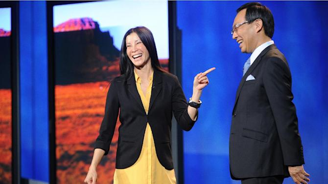 IMAGE DISTRIBUTED FOR PANASONIC - Lisa Ling and CEO of Panasonic, Kazuhiro Tsuga seen during the Panasonic keynote presentation at the International Consumer Electronics Show 2013, on Tuesday, Jan. 08, 2013, in Las Vegas, NV. (Photo by Al Powers/Invision for Panasonic/AP Images)