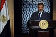 Egypt&#39;s new president-elect, Muslim Brotherhood leader Mohamed Morsi, gives a speech in the studio of the state television in Cairo. Chinese President Hu Jintao congratulated Morsi Monday for his victory in Egypt&#39;s president election, saying Beijing respected the Egyptian people&#39;s choice