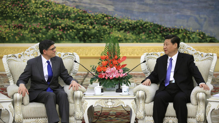 Chinese President Xi Jinping, right, speaks to U.S. Treasury Secretary Jacob Lew during their meeting at the Great Hall of the People on Tuesday, March 19, 2013, in Beijing, China. Xi  said Beijing wants strong ties with Washington as he held talks with the U.S. Treasury secretary on Tuesday in his first meeting with a foreign official since being appointed president. (AP Photo/ Feng Li, Pool)