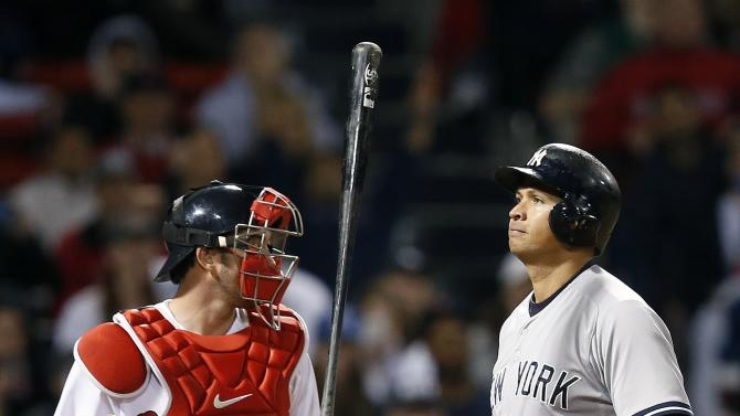 New York Yankees' Alex Rodriguez, right, flips his bat in front of Boston Red Sox's Blake Swihart after striking out during the eighth inning of a baseball game in Boston, Sunday, May 3, 2015. (AP Photo/Michael Dwyer)