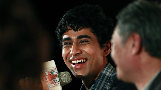 "Lead actor from India Suraj Sharma answers questions about director Ang Lee during a press conference announcing their new film ""Life of Pi,"" in Taipei, Taiwan, Wednesday, Nov. 7, 2012. ""Life of Pi"" is an upcoming 3D adventure film based on the 2001 novel of the same name by Yann Martel, staring Sharma and directed by Lee. (AP Photo/Wally Santana)"