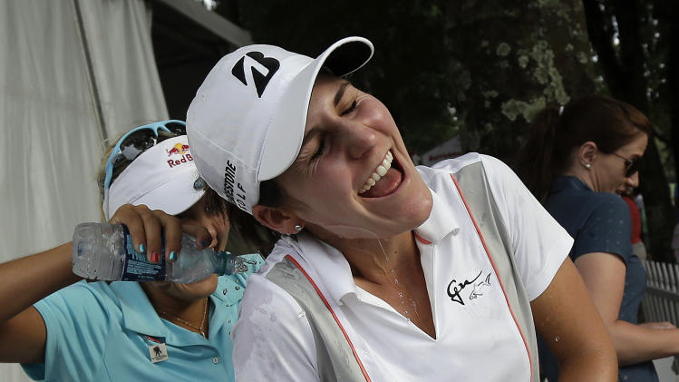 Jennifer Johnson gets doused by fellow player Lexi Thompson after she won the Mobile Bay LPGA Classic golf tournament at the Robert Trent Jones Golf Trail at Magnolia Grove in Mobile, Ala. Sunday, May 19, 2013. (AP Photo/Dave Martin)
