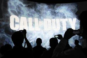 People watch a demonstration of Call of Duty at the Activision exhibit at E3, the Electronic Entertainment Expo, in Los Angeles