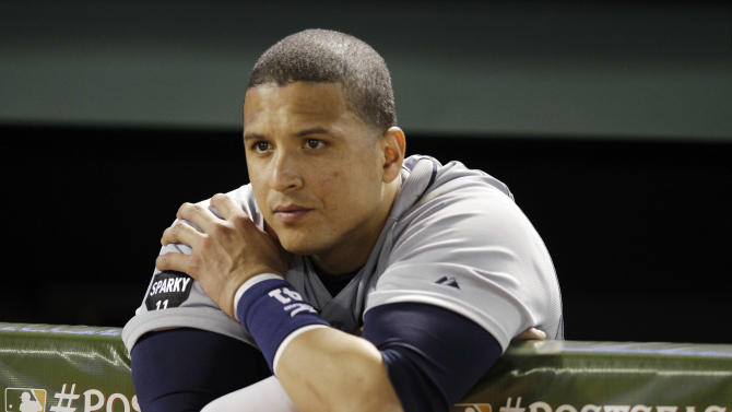 Detroit Tigers' Victor Martinez reacts   after the Texas Rangers won Game 6 of baseball's AL championship series against the Detroit Tigers 15-5, Saturday, Oct. 15, 2011, in Arlington, Texas. Texas moves on to the world series. (AP Photo/Paul Sancya)