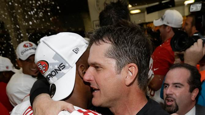San Francisco 49ers head coach Jim Harbaugh hugs Vernon Davis after the NFL football NFC Championship game against the Atlanta Falcons Sunday, Jan. 20, 2013, in Atlanta. The 49ers won 28-24 to advance to Super Bowl XLVII. (AP Photo/Dave Martin)