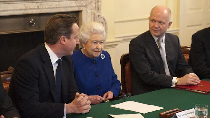 Britain's Queen Elizabeth II, center,  attends a cabinet meeting sat between British Prime Minister David Cameron, left, and Foreign Secretary William Hague in 10 Downing Street in London, Tuesday, Dec. 18, 2012.  Queen Elizabeth II sat in on a Cabinet meeting for the first time on Tuesday, taking a seat between British Prime Minister David Cameron and Foreign Secretary William Hague to observe the weekly discussion of government business. (AP Photo/Jeremy Selwyn, Pool)