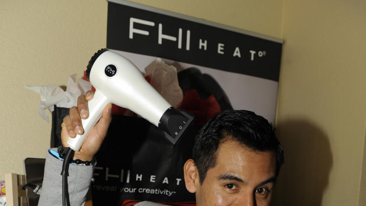Actor Eloy Mendez visits the FHI HEAT hair tools booth at the Fender Music lodge during the Sundance Film Festival on Sunday, Jan. 20, 2013, in Park City, Utah. (Photo by Jack Dempsey/Invision for Fender/AP Images)