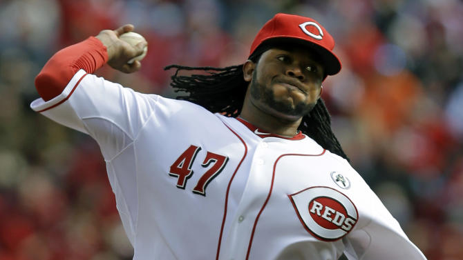 Cincinnati Reds starting pitcher Johnny Cueto throws against the Los Angeles Angels in the first inning of a baseball game, Monday, April 1, 2013, in Cincinnati. (AP Photo/Al Behrman)