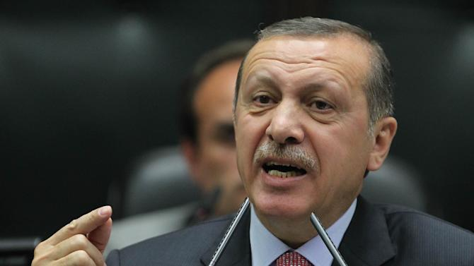 Turkey's Prime Minister Recep Tayyip Erdogan addresses the supporters and lawmakers of his ruling Justice and Development Party at the parliament in Ankara, Turkey, Tuesday, June 12, 2012. (AP Photo)