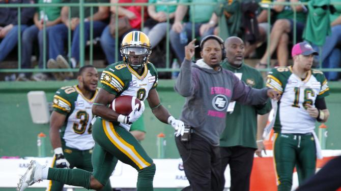 Eskimos safety Muamba runs down his interception catch against the Roughriders
