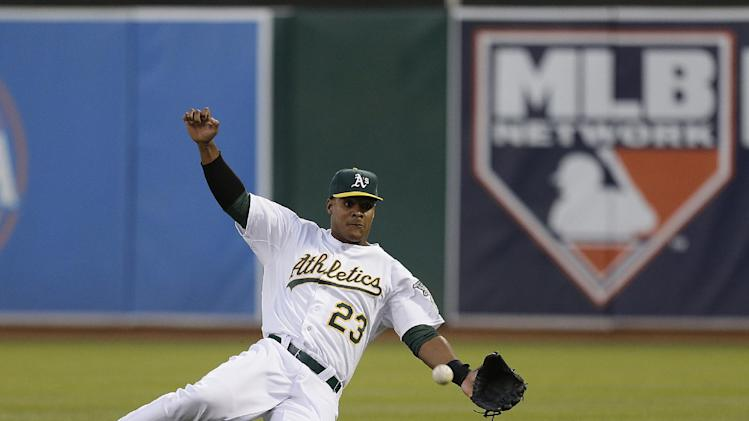 Oakland Athletics right fielder Michael Taylor can't make the catch on a double by Texas Rangers' Adrian Beltre in the fourth inning of a baseball game Tuesday, May 14, 2013, in Oakland, Calif. (AP Photo/Ben Margot)