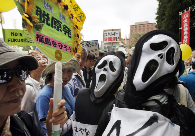 "Protesters in costume perform during the anti-nuclear demonstration in Tokyo, Monday, Sept. 19, 2011. Chanting ""Sayonara nuclear power"" and waving banners, tens of thousands of people marched in central Tokyo on Monday to call on Japan's government to abandon atomic energy in the wake of the Fukushima nuclear accident.(AP Photo/Koji Sasahara)"