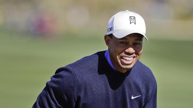 Tiger Woods reacts during a practice round for the Match Play Championship golf tournament, Tuesday, Feb. 19, 2013, in Marana, Ariz. (AP Photo/Julie Jacobson)