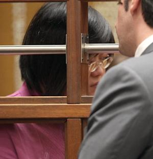 """Doctor Hsiu Ying """"Lisa"""" Tseng is shown in court, Friday March 2, 2012, to face murder charges, as her arraignment was postponed until March 9, in Los Angeles. The prosecutor took the rare step of charging this doctor, Tseng, with murder in the prescription drug overdose deaths of three patients. (AP Photo/Nick Ut)"""