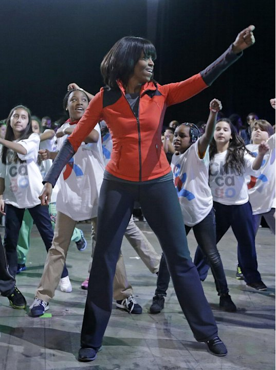 First lady Michelle Obama exercises with children from Chicago Public Schools, in her hometown of Chicago, Thursday, Feb. 28, 2013, as she makes a major announcement helping to bring back physical act