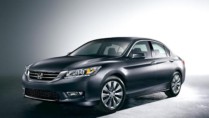 This undated product image provided by Honda shows the 2013 Honda Accord. The sedan hits showrooms in a couple weeks, with a fresh athletic look and better fuel economy. Honda, burned by criticism that it cheapened its new Civic earlier this year, says that won't happen with its newest remake. (AP Photo/Honda)