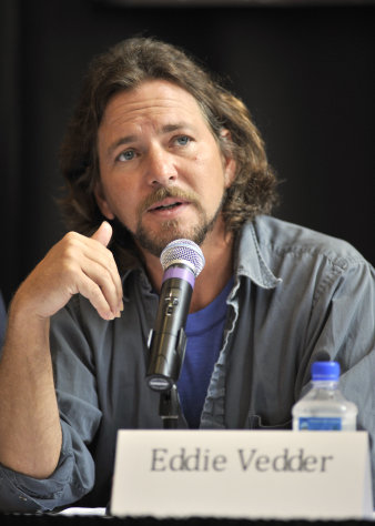 FILE - In this Aug. 28, 2010 file photo, singer Eddie Vedder of the band Pearl Jam participates in a news conference before the Voices for Justice concert in support of the West Memphis Three in Little Rock, Ark. Vedder and the rest of Pearl Jam have supported Damien Echols, Jessie Misskelley and Jason Baldwin, known as the West Memphis Three, who were convicted in 1993 for the murder of three 8-year-old boys in Arkansas. The men were recently released from prison in a legal maneuver that lets them maintain their innocence while acknowledging prosecutors have enough evidence against them. They will be on probation for the next 10 years . (AP Photo/Brian Chilson, file)