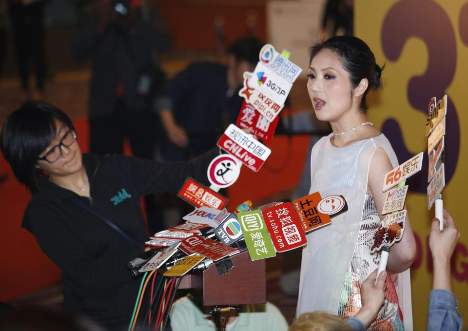 Hong Kong actress Miriam Yeung speaks to reporters at the red carpet of 37th Hong Kong International Film Festival (HKIFF) Grand Opening in Hong Kong Sunday, March 17, 2013. (AP Photo/Vincent Yu)