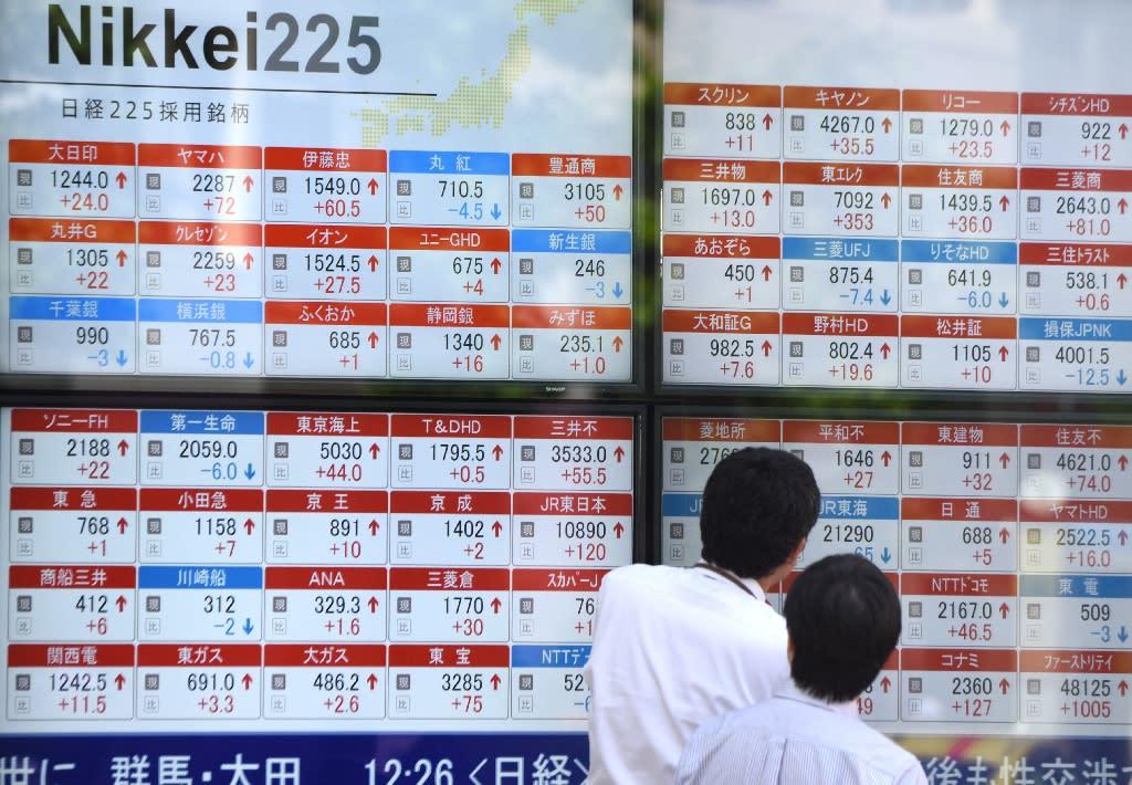 Tokyo stocks, dollar surge but Shanghai dives