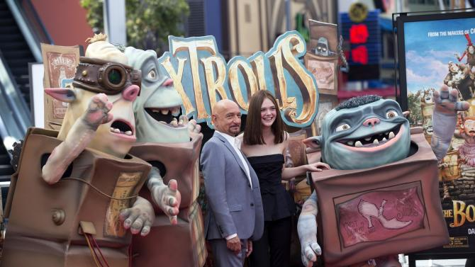 """Cast members Ben Kingsley and Elle Fanning pose with Boxtroll characters at the premiere of """"The Boxtrolls"""" at Universal Studios City Walk in Universal City, California"""