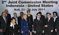 Indonesian Foreign Minister Marty Natalegawa, center right, and U.S. Secretary of State Hillary Rodham Clinton, center left, pose with officials from the U.S. and Indonesia before attending a Joint Commission meeting between the two countries in Nusa Dua on Indonesia's resort island of Bali on Sunday, July 24, 2011. (AP Photo/Saul Loeb, Pool)