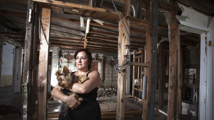 Christine Cina poses for a portrait in what is left of her house after Superstorm Sandy in the Staten Island borough of New York