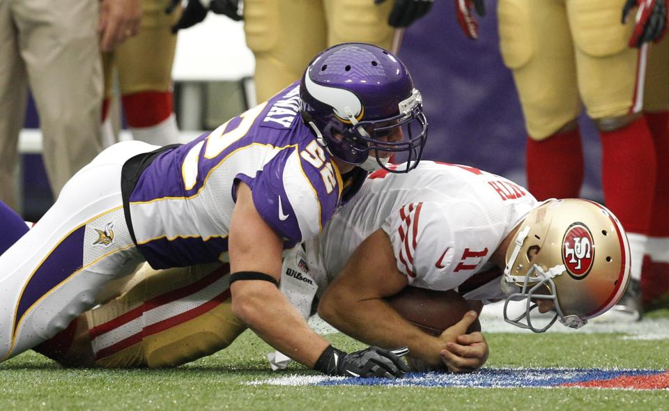 Minnesota Vikings outside linebacker Chad Greenway, left, sacks San Francisco 49ers quarterback Alex Smith during the first half of an NFL football game on Sunday, Sept. 23, 2012, in Minneapolis. (AP Photo/Genevieve Ross)