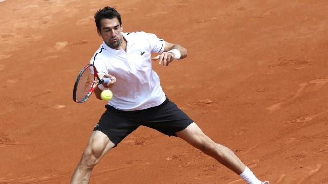 Jeremy Chardy of France plays a shot to Michael Berrer of Germany during their men's singles match at the French Open tennis tournament at the Roland Garros stadium in Paris