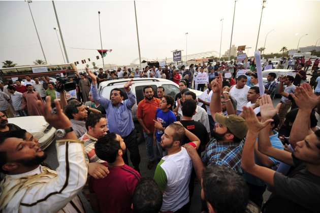 People demonstrate to demand country's National Congress and transitional government ensure police and army carry out their jobs, and that militias are dismantled, in Benghazi