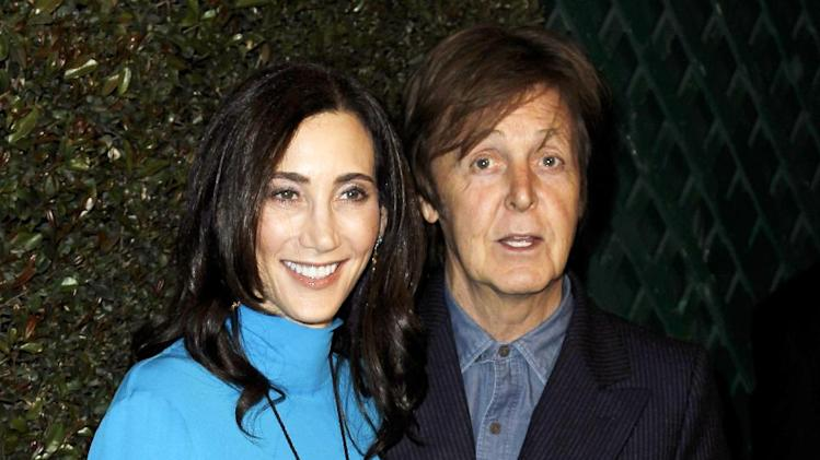 "FILE - This April 13, 2012 file photo shows Paul McCartney, right, and his wife Nancy Shevell at the world premiere of the music video for McCartney's song, ""My Valentine"", in West Hollywood, Calif.  Local media outlets report that the former Beatle accompanied his wife, Nancy Shevell, during her visit to the Syracuse, N.Y. area Wednesday, Sept. 5, for a business meeting at New England Motor Freight's operations in suburban DeWitt. Shevell is the vice president of administration for the company owned by her father, Myron Shevell.  The reports say McCartney and Nancy Shevell flew into Syracuse on a private jet and spent several hours in the area, including having lunch with company employees. Photos of McCartney with groups of workers have been posted on Facebook pages and Syracuse media websites. (AP Photo/Matt Sayles, file)"