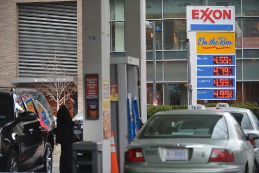 Taxis and cars at a Exxon station in the Foggy Bottom neighbourhood of Washingon, DC on February 19, 2013