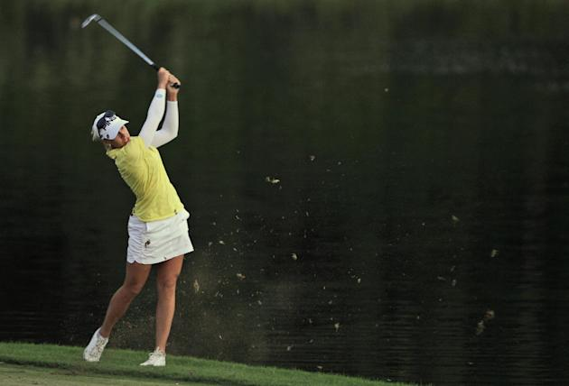 Pernilla Lindberg of Sweden plays a ball on the 9th hole during the 2nd round of Dubai Ladies Masters golf tournament in Dubai, United Arab Emirates, Thursday, Dec. 5, 2013