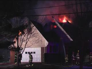 6:45: Flames shooting from roof of house in Orange Village