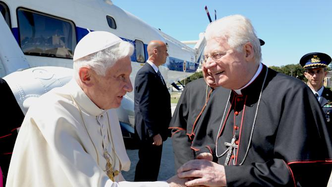 In this photo release by Vatican newspaper Osservatore Romano, Pope Benedict XVI is greeted by Cardinal Angelo Scola during his visit at Rome's Polyclinic Agostino Gemelli Hospital, Thursday, May 3, 2012. (AP Photo/Osservatore Romano, ho)