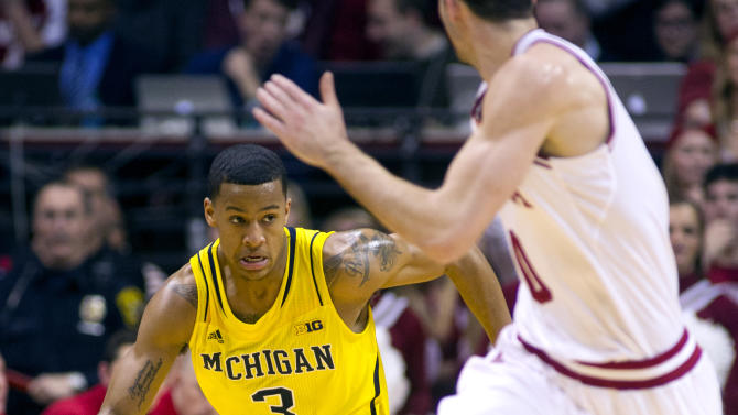 Michigan's Trey Burke (3) drives the ball up court during the first half of an NCAA college basketball game against Indiana on Saturday, Feb. 2, 2013, in Bloomington, Ind. (AP Photo/Doug McSchooler)