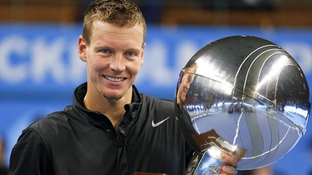 Czech Republic's Tomas Berdych displays the trophy after winning the ATP Stockholm Open tennis final against France's Jo-Wilfried Tsonga at the Royal Tennis Hall in Stockholm, October 21, 2012.