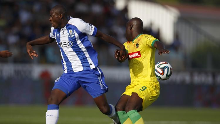 Porto's Indi fights for the ball with Pacos Ferreira's Cicero during their Portuguese Premier League soccer match at the Mata Real stadium in Pacos de Ferreira