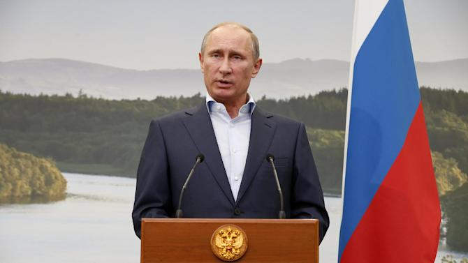 Russian President Vladimir Putin speaks during a media conference after a G-8 summit at the Lough Erne golf resort in Enniskillen, Northern Ireland, on Tuesday, June 18, 2013. The final day of the G-8 summit of wealthy nations is ending with discussions on globe-trotting corporate tax dodgers, a lunch with leaders from Africa, and suspense over whether Russia and Western leaders can avoid diplomatic fireworks over their deadlock on Syria's civil war. (AP Photo/Matt Dunham, Pool)