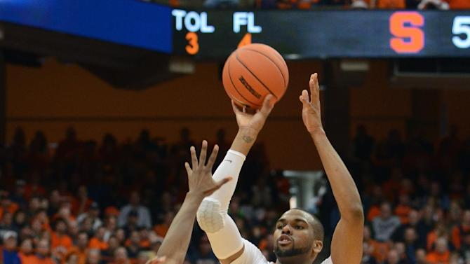 Syracuse's James Southerland shoots over St. John's Phil Greene during the second half of an NCAA college basketball game in Syracuse, N.Y., Sunday, Feb. 10, 2013. Syracuse won 77-58. (AP Photo/Kevin Rivoli)