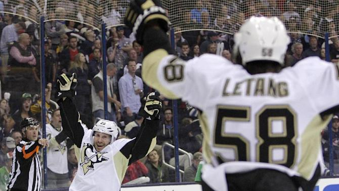 Pittsburgh Penguins' Lee Stempniak, left, celebrates his goal against the Columbus Blue Jackets' during the third period of a first-round NHL playoff hockey game Monday, April 21, 2014, in Columbus, Ohio. The Penguins defeated the Blue Jackets 4-3