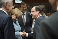 <p>Italian Prime Minister Mario Monti (left) and Spanish Prime Minister Mariano Rajoy (centre) look on as German Chancellor Angela Merkel and French President Francois Hollande shake hands prior to a meeting of European Union leaders in Brussels on May 23. Leaders of the eurozone's four biggest economies gather in Rome Friday to thrash out ideas to tackle the debt crisis</p>