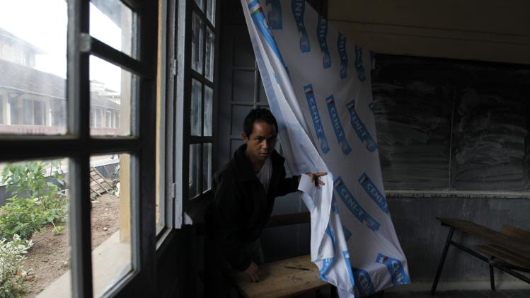 An electorate is seen before casts his vote at a polling centre in the capital Antananarivo
