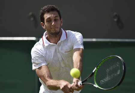 James Ward of Britain hits a shot during his match against Jiri Vesely of the Czech Republic at the Wimbledon Tennis Championships in London