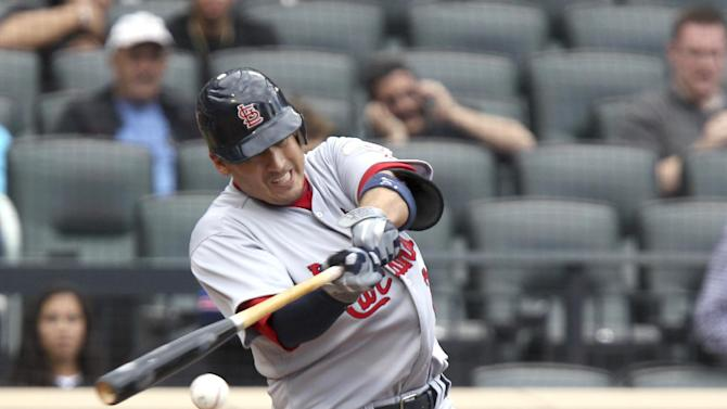 St. Louis Cardinals' Allen Craig singles to score Matt Holliday during the fourth inning of the baseball game against the New York Mets Monday, June 4, 2012, at Citi Field in New York.  (AP Photo/Seth Wenig).