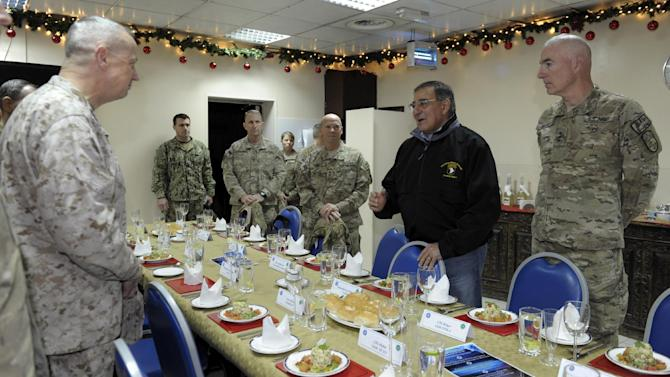 Defense Secretary Leon Panetta, second from right, stands across from Marine Gen. John R. Allen, commander of International Security Assistance Force, left, as he speaks before a dinner with commanders at International Security Assistance Force headquarters in Kabul, Afghanistan, Wednesday, Dec. 12, 2012. (AP Photo/Susan Walsh, Pool)
