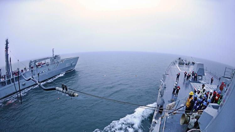 In this March 17, 2013 photo provided by the U.S. Navy, the Arleigh Burke-class guided-missile destroyer USS McCampbell, right, conducts a replenishment-at-sea with South Korean Navy Cheonji-class fast combat support ship ROKS Cheonji during exercise Foal Eagle 2013 in the West Sea, South Korea. (AP Photo/U.S. Navy, Mass Communication Specialist 3rd Class Declan Barnes)